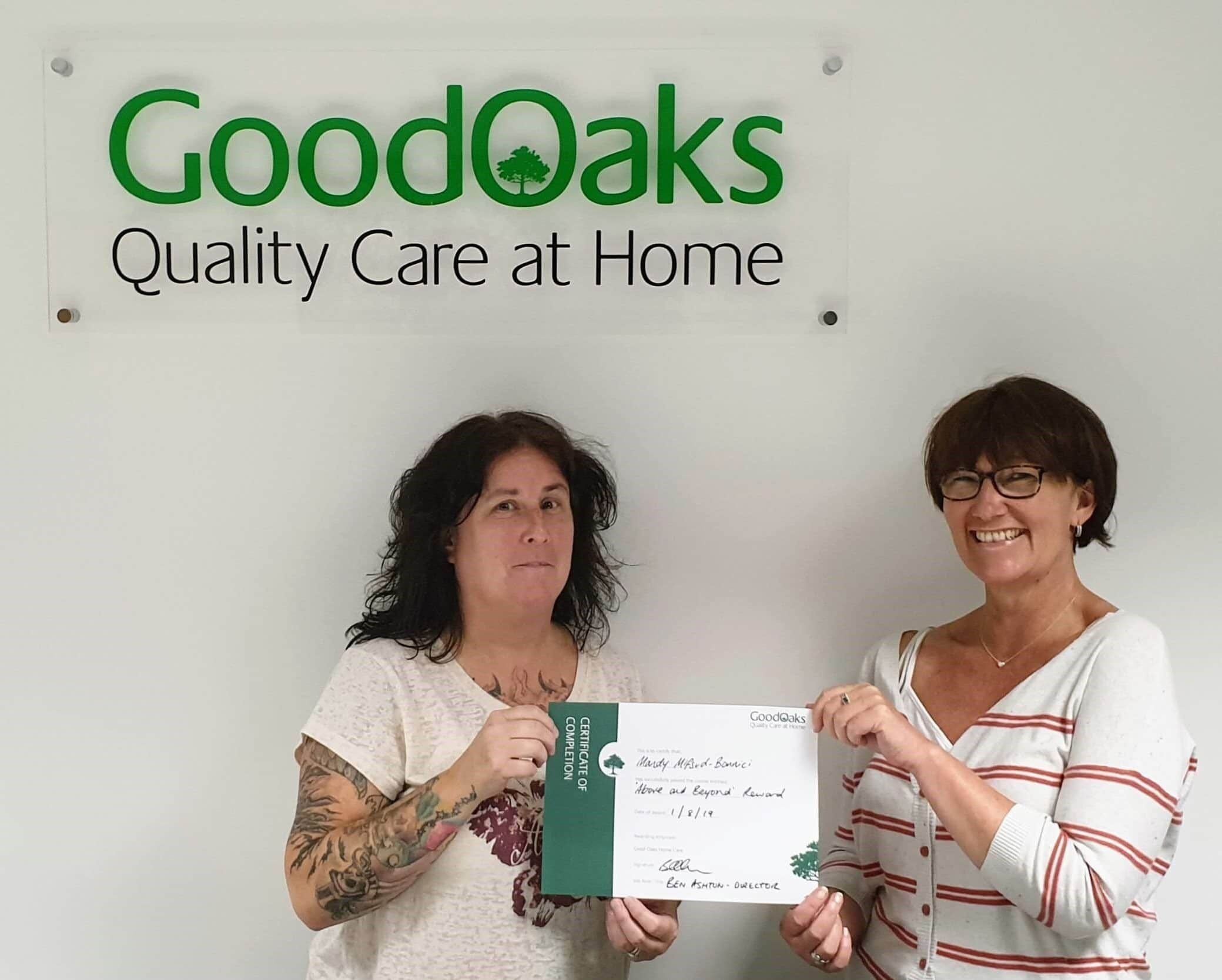 Home Carer with Good Oaks Trainer holding certificate